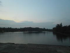 Dusk falls over Angkor Wat's huge moat.