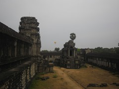 Looking westward along Angkor's galleries, the tethered hot air balloon visible in the distance.