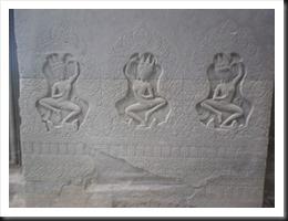 Three aspara in the northern 'library' of Angkor Wat.